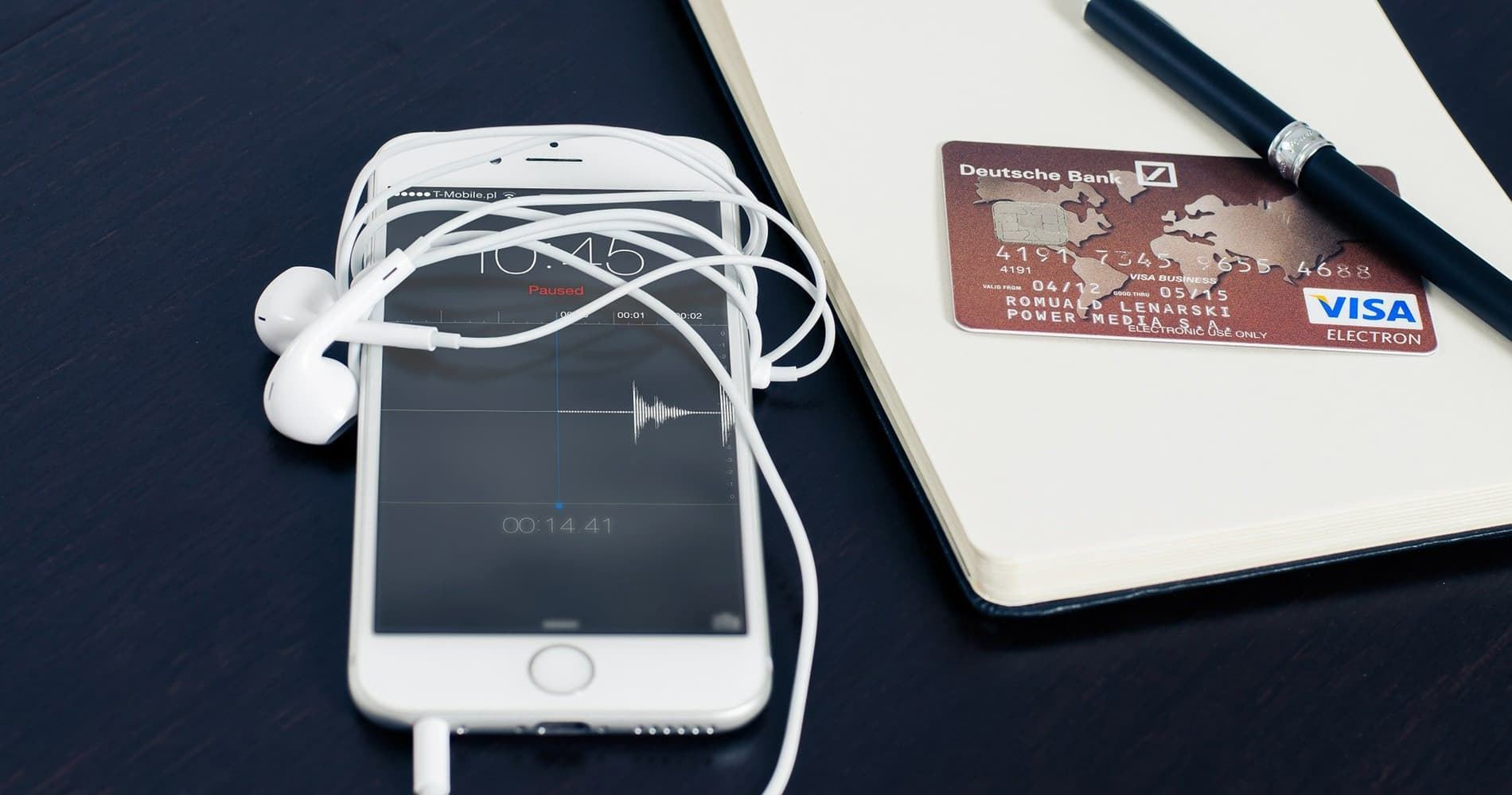 A cell phone, headphones, and a credit card used for eCommerce